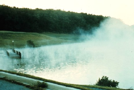 Wispy lake or steam fog