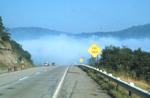 Valley fog with roadsign