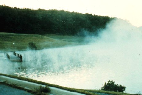 Wispy lake or steam fog